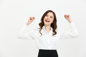 Business Concept: young happy businesswoman with hands in the air is celebrating success on white background