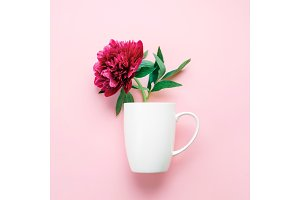 A cup with pink flower.