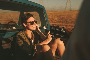 Woman enjoying on a road trip