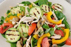 Warm chicken salad with vegetables