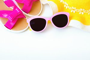 Summer accessories for modern woman on her vacation. Top view. White background with copy space.