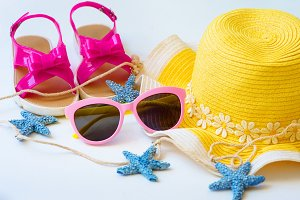 summer background of desk and hat and glasses