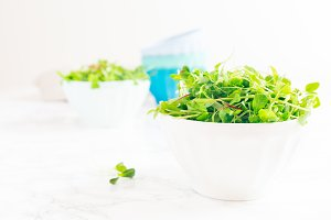 Mixed baby greens salad in bowl