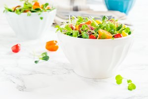 Mixed baby greens and cherry tomato
