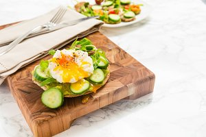 Raw healthy burger with poached egg