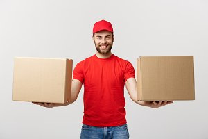 Delivery Concept: Portrait smiling delivery man giving cardbox on white background.