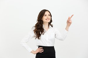 Business Concept Portrait of smiling business woman pointing finger on copy space. iswolated portrait.