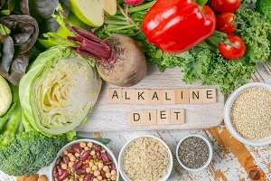 Alkaline diet concept - fresh foods on rustic background