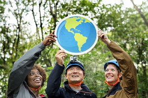 Group of people holding earth icon