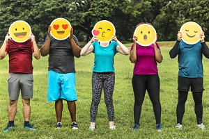 Diverse people with emoticon