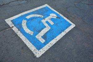Disabled blue parking sign
