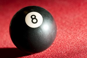 Black ball on pool billiard-table