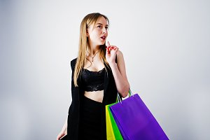 Girl in black with shopping bags
