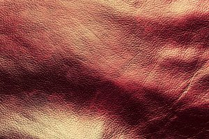 Genuine dark red leather background