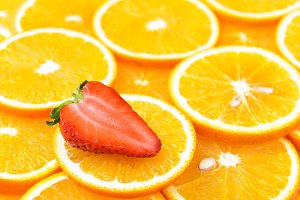 Fresh orange slices with strawberry
