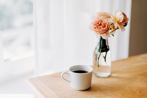 Coffee and roses by the window
