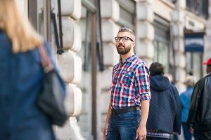 Hipster man with eyeglasses shopping in streets of London