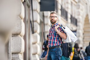 Hipster man shopping in the streets of London