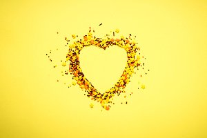 Nonpareil in shape of a heart on yellow background