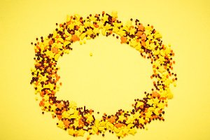 Colorful nonpareil on yellow background