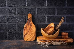 Wooden dishes on a brick wall background