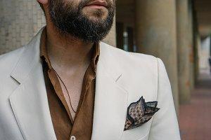 gentleman in beige suit