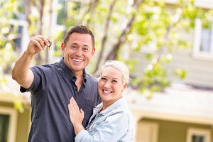 Couple in Front of House with Keys