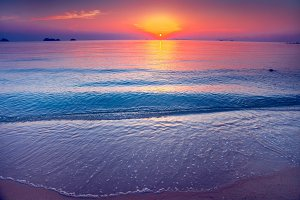 The sand shore and the ocean. Sunset. Thailand.