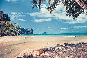 Ocean shore next to the tropical island. Thailand.