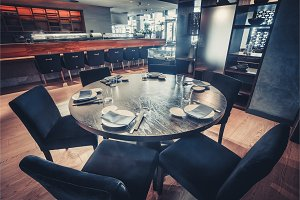 The round table and the chairs. Restaurant decor.