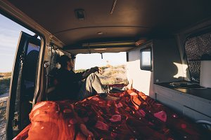 Adventurous man in interior of a van