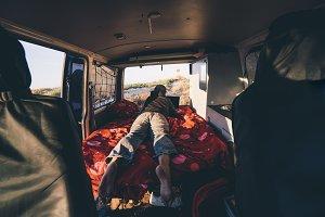 Adventurous man in interior of a van