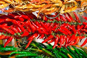 Bunches of red and green hot peppers