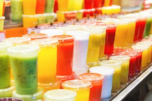 Many glasses with fruit milkshake