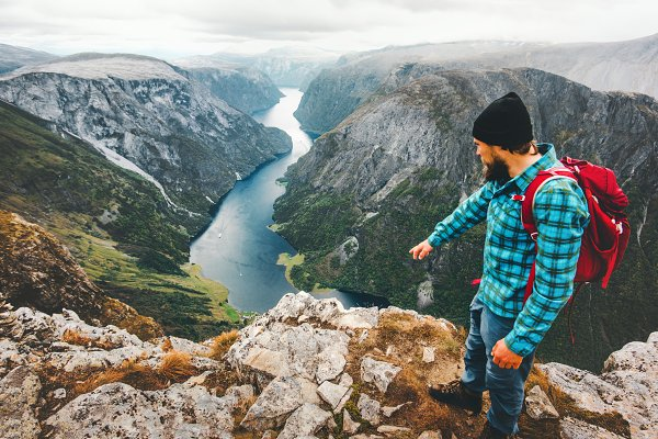People Stock Photos: e v e r s t - Travel Man with backpack on cliff