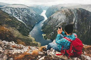Man traveler using smartphone