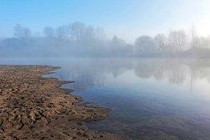 River beach and fog