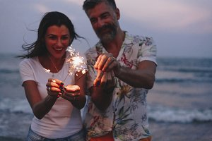 Couple celebrating with sparklers