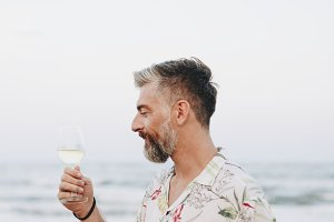 Man drinking a glass of wine