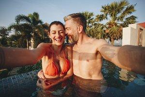 Honeymooners in a swimming pool