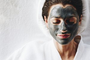 Woman relaxing with a facial mask