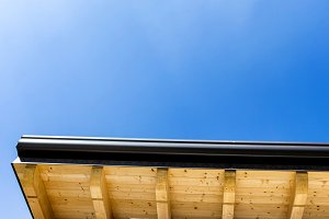 Corner of house with wooden beams an