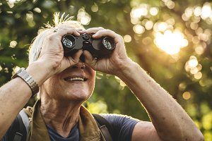Senior using binoculars