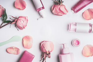 Flat lay frame of roses cosmetic