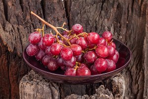 Red grapes in plate