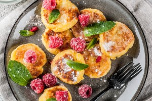 Cheese pancakes with raspberry