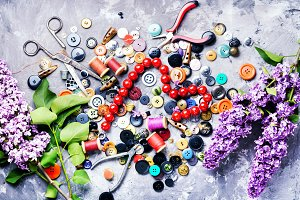 Tools for needlework and lilac branc