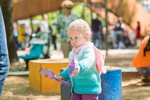 A child plays in a sandbox