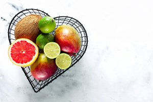 exotic fruits in a basket in the form of a heart. picture from a