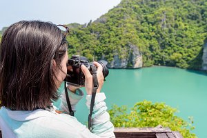Woman tourist taking photos of Thale Nai